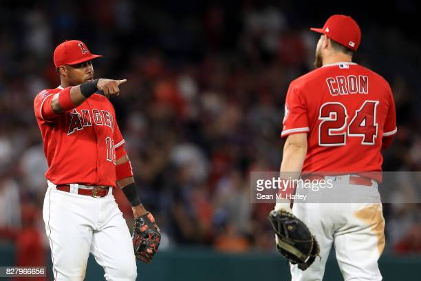 Luis Valbuena congraulates CJ Cron of the Los Angeles Angels of Anaheim after defeating the Baltimore Orioles 32 in a game at Angel Stadium of...