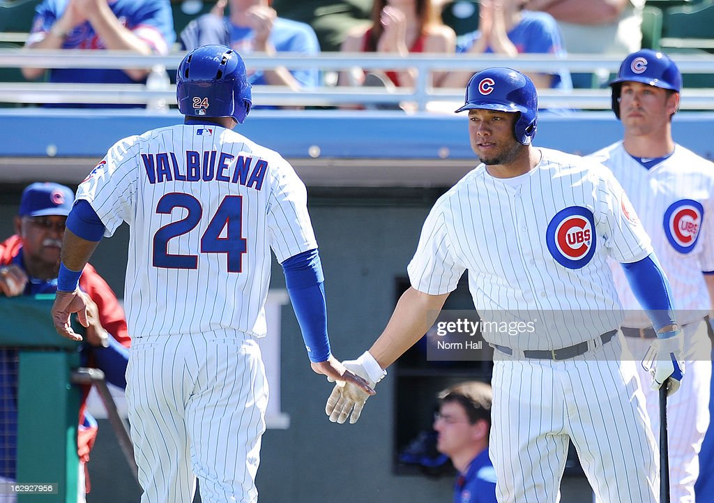 Luis Valbuena #24 of the Chicago Cubs and teammate <a gi-track='captionPersonalityLinkClicked' href=/galleries/search?phrase=Welington+Castillo&family=editorial&specificpeople=4959193 ng-click='$event.stopPropagation()'>Welington Castillo</a> #53 celebrate scoring a run against the Arizona Diamondbacks at Hohokam Stadium on March 1, 2013 in Mesa, Arizona.
