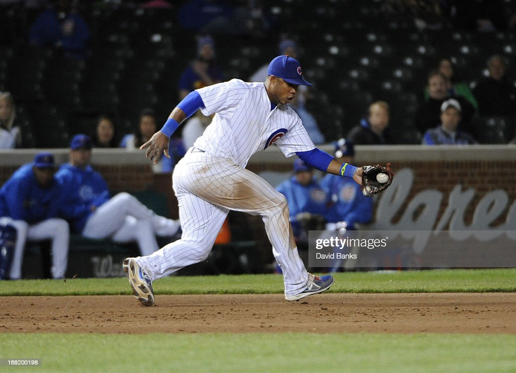 Luis Valbuena #24 of the Chicago Cubs fields a ground ball against the Texas Rangers during the ninth inning on May 6, 2013 at Wrigley Field in Chicago, Illinois. The Chicago Cubs defeated the Texas Rangers 9-2.