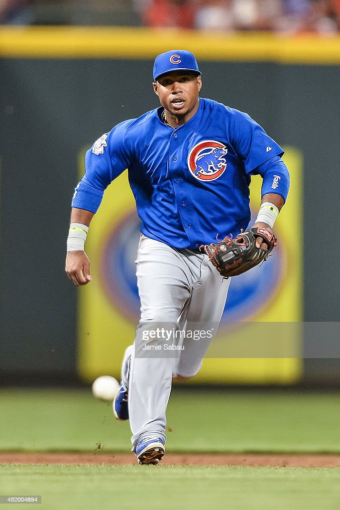 Luis Valbuena #24 of the Chicago Cubs fields a ground ball and throws to first base against the Cincinnati Reds at Great American Ball Park on July 9, 2014 in Cincinnati, Ohio.