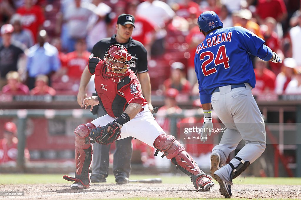 <a gi-track='captionPersonalityLinkClicked' href=/galleries/search?phrase=Luis+Valbuena&family=editorial&specificpeople=5537111 ng-click='$event.stopPropagation()'>Luis Valbuena</a> #24 of the Chicago Cubs gets tagged out at home plate by <a gi-track='captionPersonalityLinkClicked' href=/galleries/search?phrase=Devin+Mesoraco&family=editorial&specificpeople=5745587 ng-click='$event.stopPropagation()'>Devin Mesoraco</a> #39 of the Cincinnati Reds while trying to stretch a triple in the 12th inning of the game at Great American Ball Park on July 10, 2014 in Cincinnati, Ohio. The Cubs won 6-4.