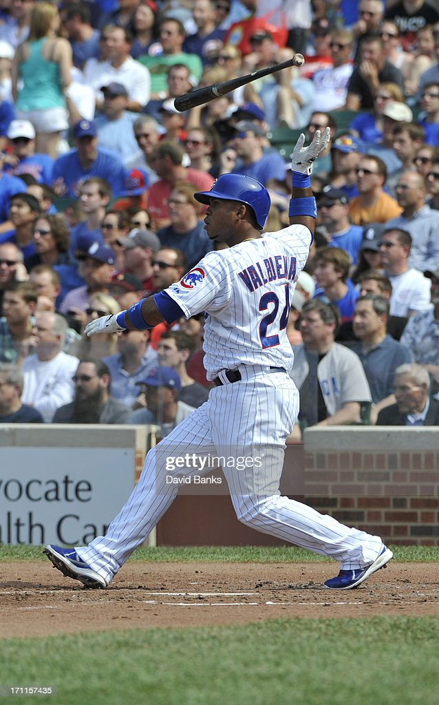 Luis Valbuena #24 of the Chicago Cubs hits a two RBI single against the Houston Astros during the third inning on June 22, 2013 at Wrigley Field in Chicago, Illinois.