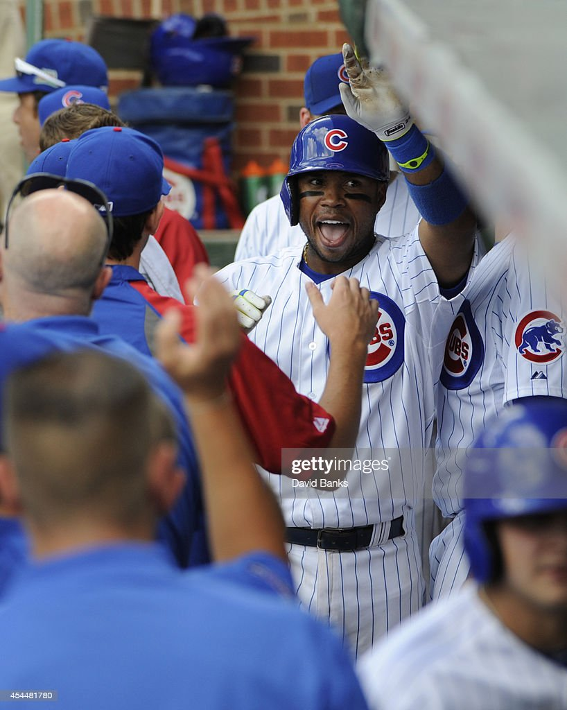 Luis Valbuena #24 of the Chicago Cubs is congratulated after hitting a home run against the Milwaukee Brewers during the eighth inning on September 1, 2014 at Wrigley Field in Chicago, Illinois. The Chicago Cubs defeated the Milwaukee Brewers 4-2.