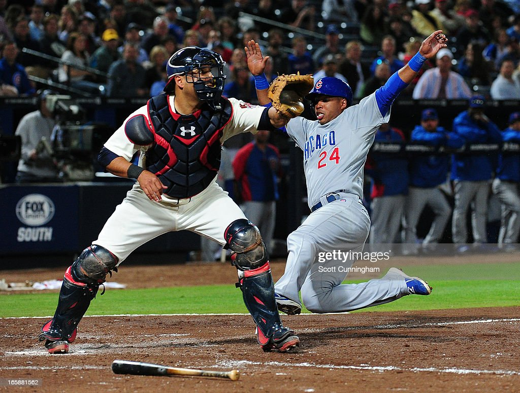 Luis Valbuena #24 of the Chicago Cubs is forced out at home by <a gi-track='captionPersonalityLinkClicked' href=/galleries/search?phrase=Gerald+Laird&family=editorial&specificpeople=228949 ng-click='$event.stopPropagation()'>Gerald Laird</a> #11 of the Atlanta Braves at Turner Field on April 6, 2013 in Atlanta, Georgia.
