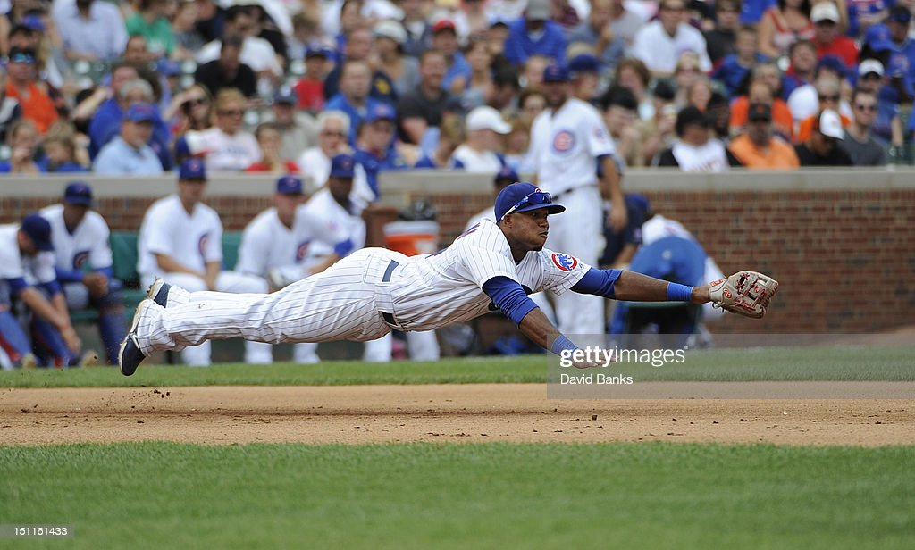 Luis Valbuena #24 of the Chicago Cubs makes a diving catch against the San Francisco Giants in the fifth inning on September 02 2012 at Wrigley Field in Chicago, Illinois.