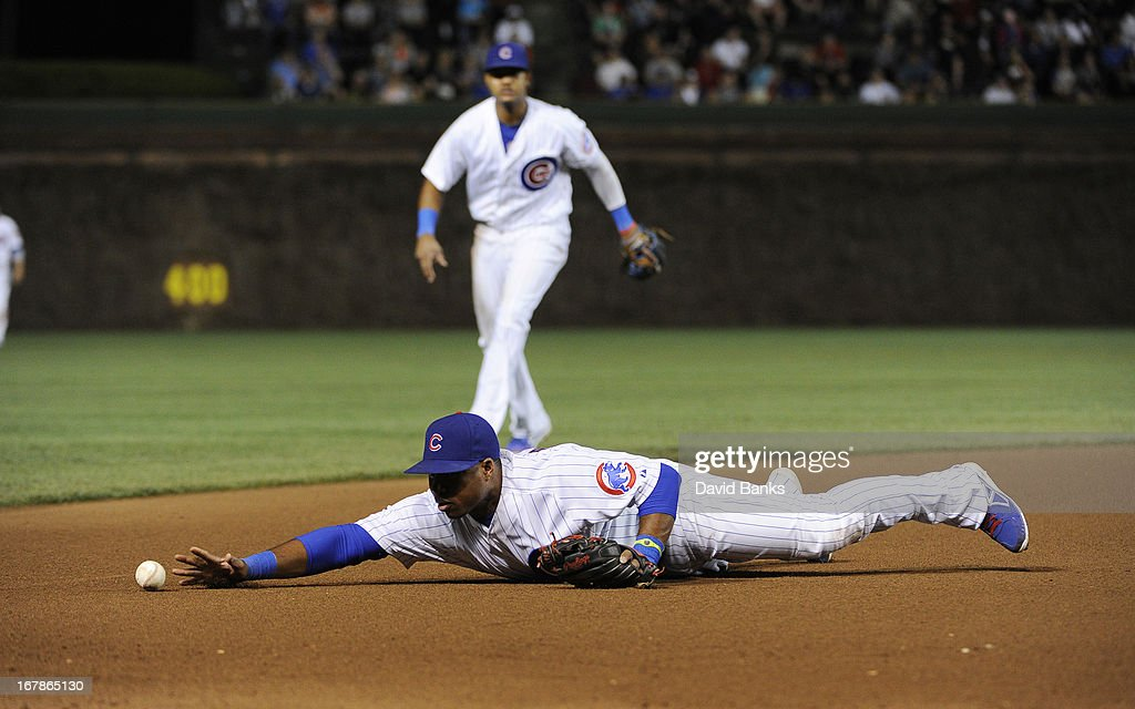 Luis Valbuena #24 of the Chicago Cubs makes an error against the San Diego Padres during the seventh inning on May 1, 2013 at Wrigley Field in Chicago, Illinois.