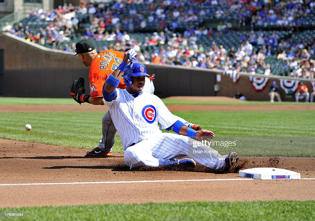 <a gi-track='captionPersonalityLinkClicked' href=/galleries/search?phrase=Luis+Valbuena&family=editorial&specificpeople=5537111 ng-click='$event.stopPropagation()'>Luis Valbuena</a> #24 of the Chicago Cubs (R) slides into third base as third baseman <a gi-track='captionPersonalityLinkClicked' href=/galleries/search?phrase=Placido+Polanco&family=editorial&specificpeople=213170 ng-click='$event.stopPropagation()'>Placido Polanco</a> #30 of the Miami Marlins waits for the throw from the outfield after Anthony Rizzo #44 of the Chicago Cubs hit an RBI single scoring Starlin Castro #13 at Wrigley Field on September 2, 2013 in Chicago, Illinois The Marlins defeated the Cubs 4-3.