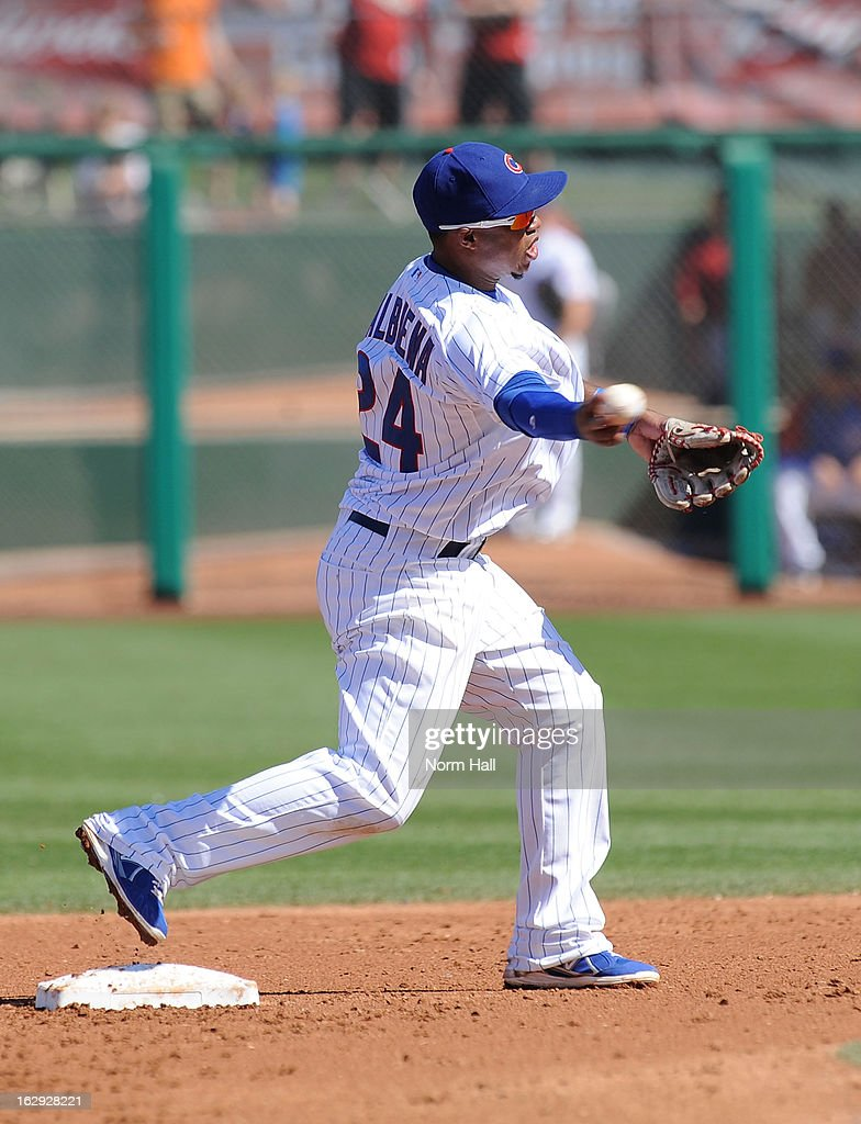 Luis Valbuena #24 of the Chicago Cubs turns a double play against the Arizona Diamondbacks at Hohokam Stadium on March 1, 2013 in Mesa, Arizona.