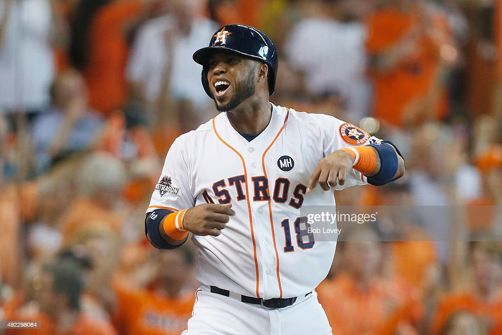 Luis Valbuena #18 of the Houston Astros celebrates after scoring a run in the fifth inning against the Kansas City Royals in game three of the American League Division Series at Minute Maid Park on October 11, 2015 in Houston, Texas.