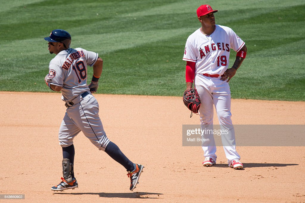 <a gi-track='captionPersonalityLinkClicked' href=/galleries/search?phrase=Luis+Valbuena&family=editorial&specificpeople=5537111 ng-click='$event.stopPropagation()'>Luis Valbuena</a> #18 of the Houston Astros runs the bases while Jefry Marte #19 of the Los Angeles Angels of Anaheim reacts after Valbuena hit a solo home run during the seventh inning of the game at Angel Stadium of Anaheim on June 29, 2016 in Anaheim, California.