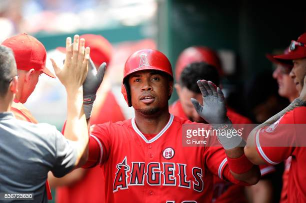 Luis Valbuena of the Los Angeles Angels celebrates with teammates after hitting a home run against the Washington Nationals at Nationals Park on...