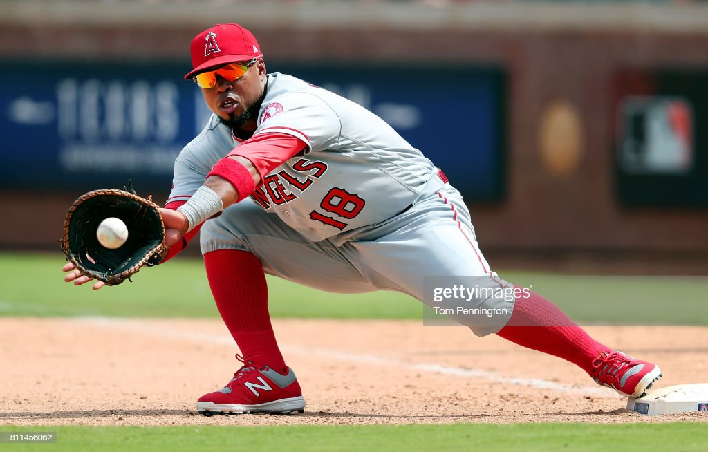 Luis Valbuena #18 of the Los Angeles Angels makes the out against the Texas Rangers in the bottom of the seventh inning at Globe Life Park in Arlington on July 9, 2017 in Arlington, Texas.