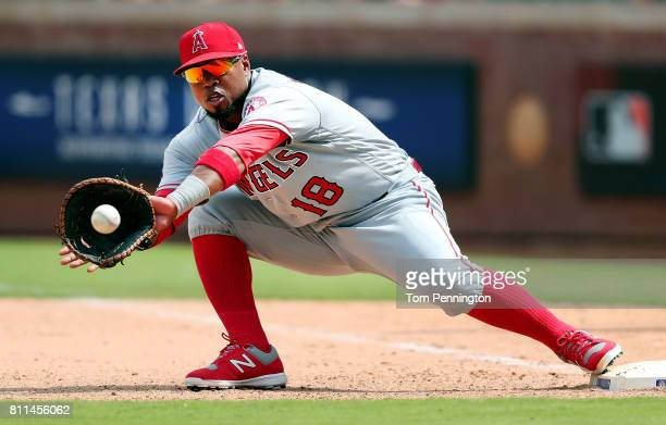 Luis Valbuena of the Los Angeles Angels makes the out against the Texas Rangers in the bottom of the seventh inning at Globe Life Park in Arlington...