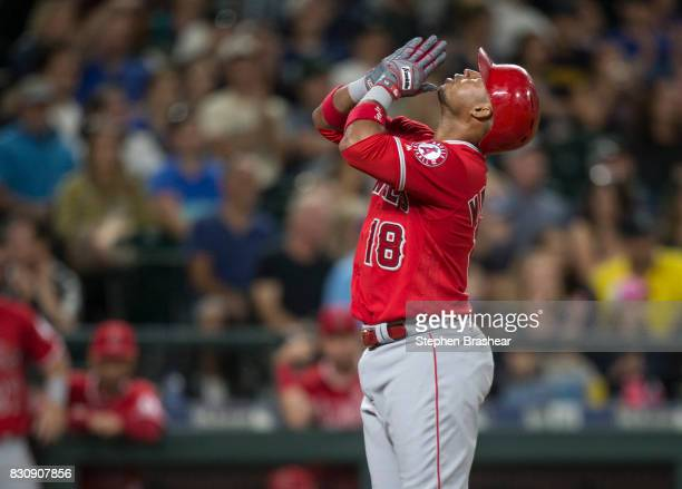 Luis Valbuena of the Los Angeles Angels of Anaheim celebrates after hitting a tworun home run off o relief pitcher Casey Lawrence of the Seattle...