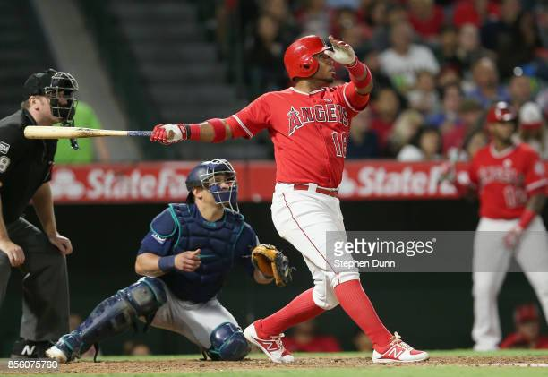 Luis Valbuena of the Los Angeles Angels of Anaheim hits a sarifice fly to bring in Brandon Phillips with a run in the fourth inning against the...