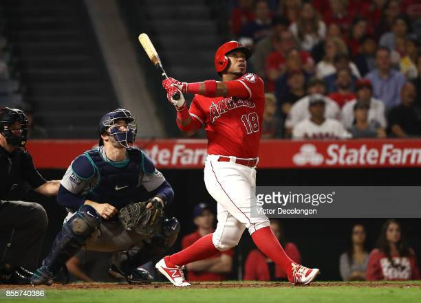 Luis Valbuena of the Los Angeles Angels of Anaheim hits a tworun rbi double for a 65 lead as catcher Mike Zunino of the Seattle Mariners watches the...