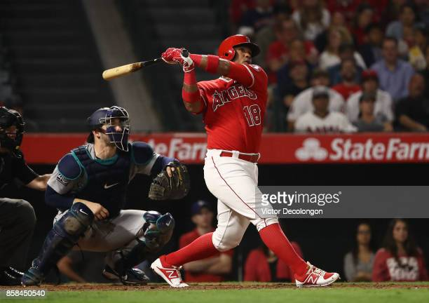 Luis Valbuena of the Los Angeles Angels of Anaheim hits a tworun rbi double to rifht field during the eighth inning of the MLB game against the...