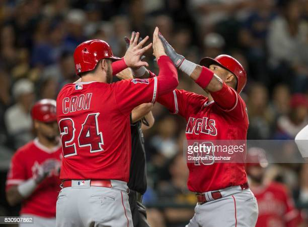 Luis Valbuena of the Los Angeles Angels of Anaheim is greeted by CJ Cron of the Los Angeles Angels of Anaheim after hitting tworun home run off of...