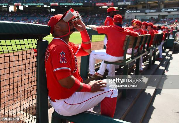 Luis Valbuena of the Los Angeles Angels of Anaheim looks into the crowd with binoculars made from paper cups and tape during the game against the...