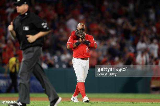 Luis Valbuena of the Los Angeles Angels of Anaheim looks to the sky after defeating the Baltimore Orioles 32 in a game at Angel Stadium of Anaheim on...
