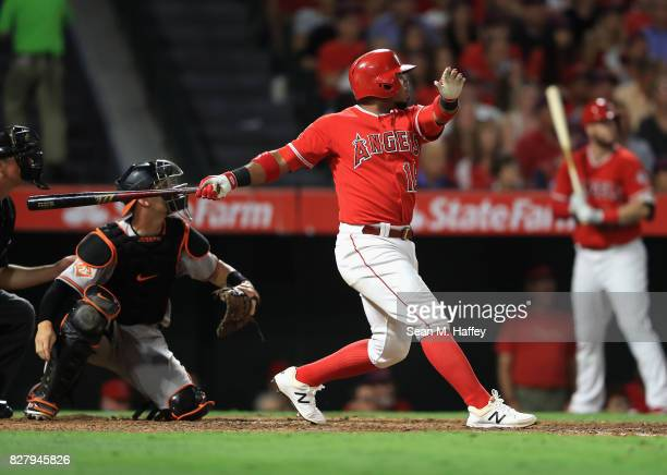 Luis Valbuena of the Los Angeles Angels of Anaheim looks up after hitting an RBI double as Caleb Joseph of the Baltimore Orioles looks on during the...