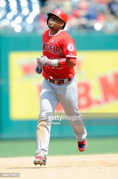 Luis Valbuena of the Los Angeles Angels rounds the bases after hitting a home run against the Washington Nationals at Nationals Park on August 16...