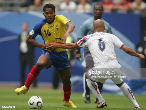 Luis Valencia of Ecuador skips past Danny Fonseca of Costa Rica