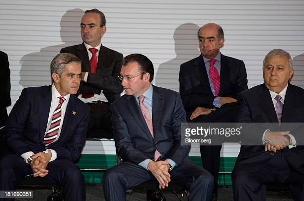 Luis Videgaray Mexico's finance minister center speaks with Miguel Angel Mancera mayor of Mexico City left while sitting with Emilio Chuayffet...