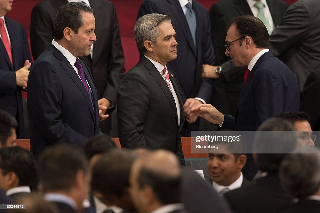 Luis Videgaray, Secretary of Finance, right, speaks with Eruviel Avila, Governor of the state of Mexico, left, and Miguel Angel Mancera, Mexico City's Mayor, after annual state of the union address at the National Palace in Mexico City, Mexico, on Wednesday, Sept. 2, 2015. Mexican president Enrique Pena Nieto gave his annual speech to the nation, saying it has been a difficult year and Mexico needs to reduce violence across the country. Photographer: Susana Gonzalez/Bloomberg via Getty Images