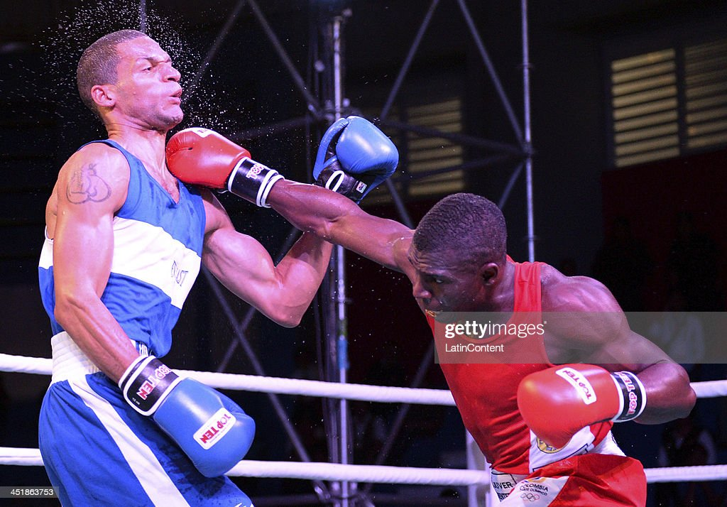 Luis Vivas of Colombia (RED) fights with Augusto Leturia of Peru (BLUE) in Men's 75 kg as part of the XVII Bolivarian Games Trujillo 2013 at Colegio Nuestra Señora del Rosario on November 24, 2013 in Chiclayo, Peru.