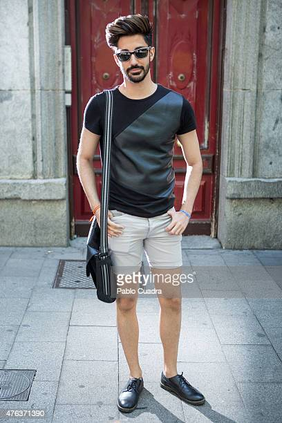 Luis wears Springfield shoes HM trousers Zara tshirt Primark handbag and Ray ban sunglasses on June 8 2015 in Madrid Spain