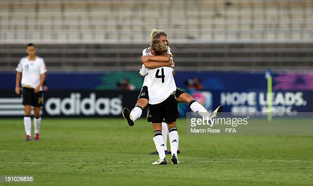 Luisa Wensing of Germany celebrate with team mate Jennifer Cramer after the FIFA U20 Women's World Cup Japan 2012 Quarter Final match between Germany...