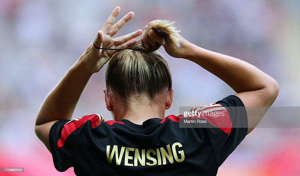 Luisa Wensing of Germany prepairs her hair during the Women's International Friendly match between Germany and Canada at Benteler Arena on June 19, 2013 in Paderborn, Germany.