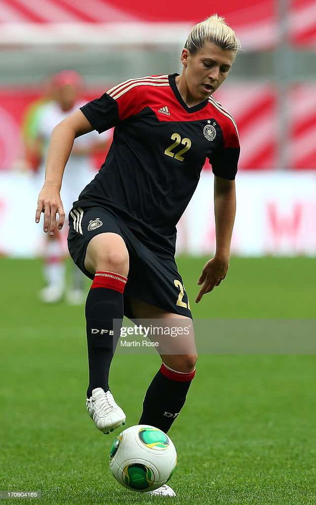 Luisa Wensing of Germany runs with the ball during the Women's International Friendly match between Germany and Canada at Benteler Arena on June 19, 2013 in Paderborn, Germany.