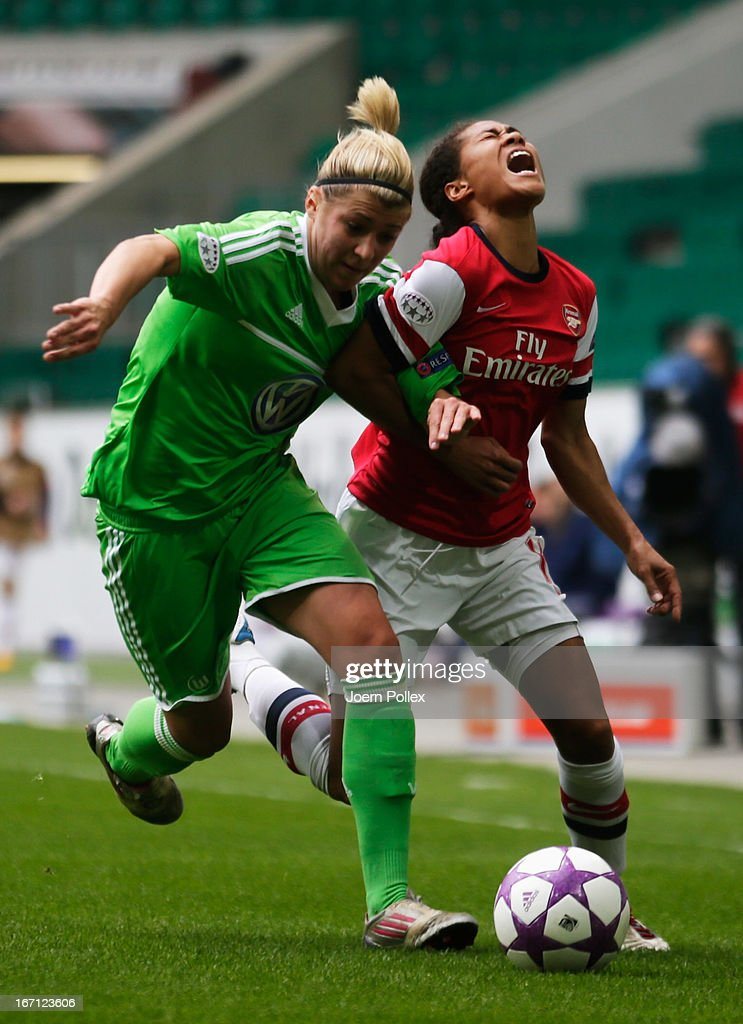 Luisa Wensing (L) of Wolfsburg and <a gi-track='captionPersonalityLinkClicked' href=/galleries/search?phrase=Rachel+Yankey&family=editorial&specificpeople=235431 ng-click='$event.stopPropagation()'>Rachel Yankey</a> of Arsenal compete for the ball during the Women's Champions League semi-final second leg match between VfL Wolfsburg and Arsenal Ladies FC at Volkswagen Arena on April 21, 2013 in Wolfsburg, Germany.