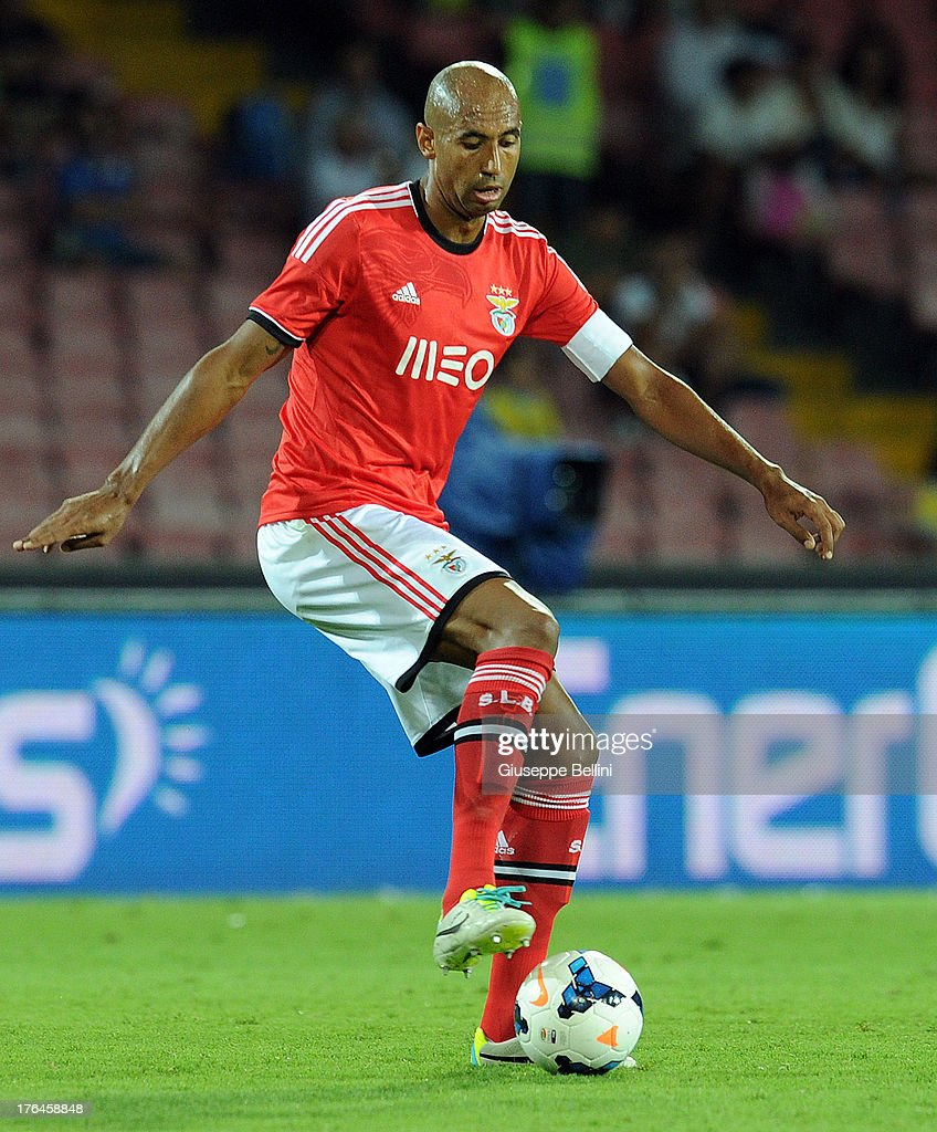<a gi-track='captionPersonalityLinkClicked' href=/galleries/search?phrase=Luisao&family=editorial&specificpeople=490899 ng-click='$event.stopPropagation()'>Luisao</a> of Benfca in action during the pre-season friendly match between SSC Napoli and SL Benfica at Stadio San Paolo on August 9, 2013 in Naples, Italy.