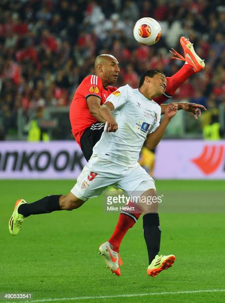 Luisao of Benfica and Carlos Bacca of Sevilla battle for the ball during the UEFA Europa League Final match between Sevilla FC and SL Benfica at...