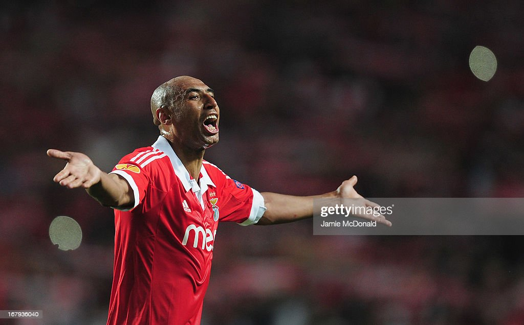 <a gi-track='captionPersonalityLinkClicked' href=/galleries/search?phrase=Luisao&family=editorial&specificpeople=490899 ng-click='$event.stopPropagation()'>Luisao</a> of Benfica celebrates victory during the UEFA Europa League semi final second leg match between SL Benfica and Fenerbahce SK at the Estadio da Luz on May 2, 2013 in Lisbon, Portugal.