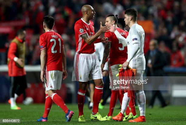 Luisao of Benfica celebrates with goalkeeper Ederson after winning the UEFA Champions League Round of 16 first leg match between SL Benfica and...