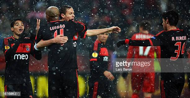 Luisao of Benfica celebrates with Nemanja Matic and other team mates after winning the UEFA Europa League Round of 32 first leg between Bayer 04...