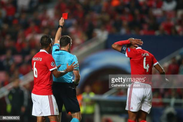 Luisao of Benfica is shown a red card and sent off during the UEFA Champions League group A match between SL Benfica and Manchester United at Estadio...