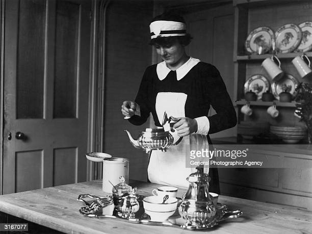 Luise Horner an Austrian working as a maid in England prepares afternoon tea