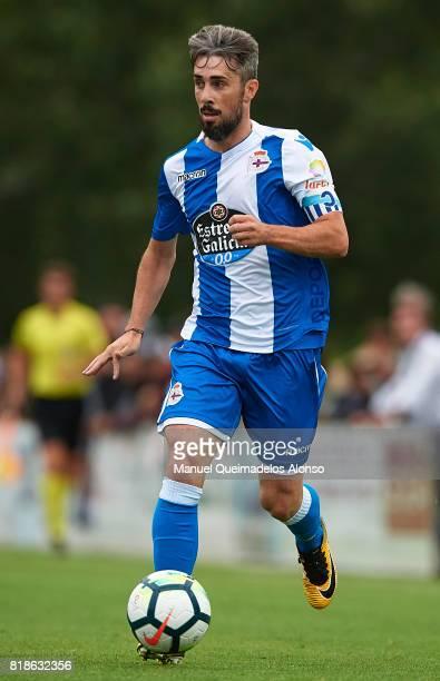 Luisinho Correia of Deportivo de La Coruna runs with the ball during the preseason friendly match between Cerceda and Deportivo de La Coruna at O...