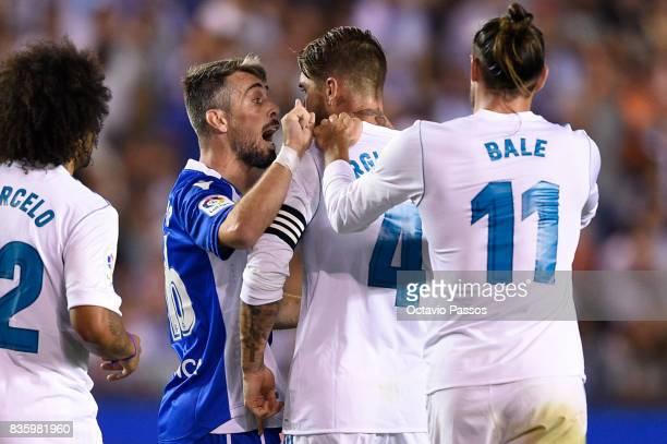 Luisinho of RC Deportivo La Coruna argues with Sergio Ramos of Real Madrid during the La Liga match between Deportivo La Coruna and Real Madrid at...