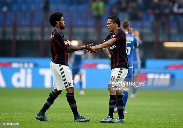 Luiz Adriano and Carlos Bacca of AC Milan celebrate at the end of the Serie A match between AC Milan and US Sassuolo Calcio at Stadio Giuseppe Meazza...