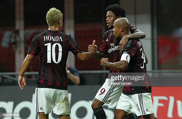 Luiz Adriano of AC Milan celebrates his goal with his teammates Nigel De Jong and Keisuke Honda during the TIM Cup match between AC Milan and AC...