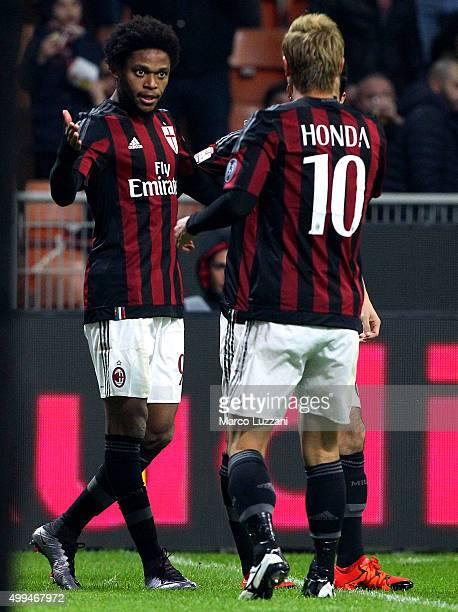 Luiz Adriano of AC Milan celebrates with his teammate Keisuke Honda after scoring the opening goal during the TIM Cup match between AC Milan and FC...