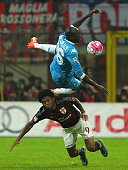 Luiz Adriano of AC Milan competes for the ball with Kalidou Koulibaly of SSC Napoli during the Serie A match between AC Milan and SSC Napoli at...