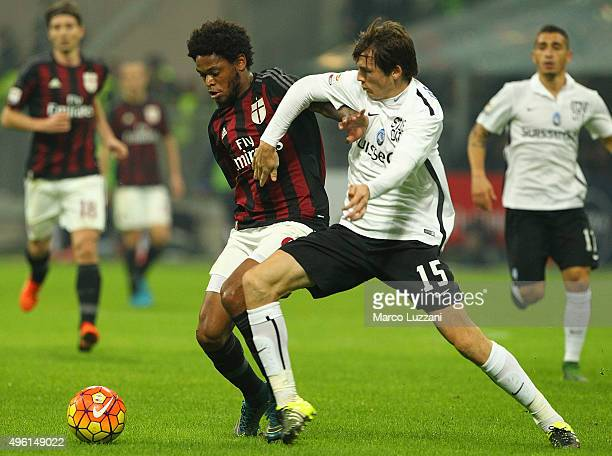 Luiz Adriano of AC Milan competes for the ball with Marten De Roon of Atalanta BC during the Serie A match between AC Milan and Atalanta BC at Stadio...