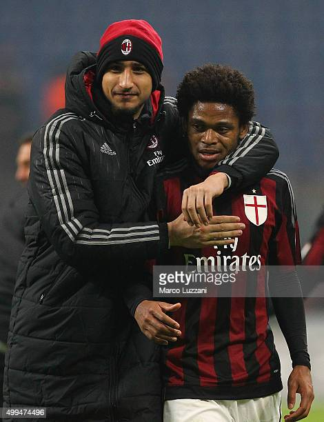 Luiz Adriano of AC Milan embraces Gianluigi Donnarumma at the end of the TIM Cup match between AC Milan and FC Crotone at Stadio Giuseppe Meazza on...